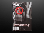 Front cover of 2600: The Hacker Quarterly - Summer 2017. #winning. Black and white photograph of a middle-aged white man in a beanie hat and hoodie holding up his middle finger, which is blurred out.