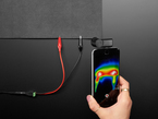 High-Conductivity Heater Fabric powered, with thermal camera showing heated area
