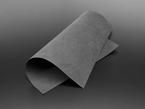 Square of black felt fabric curled over