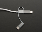 Cable with the Lightning adaptor inserted above the USB Micro B connector end.