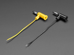Angled shot of the Banana Plugs with cables attached in both black and yellow.
