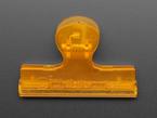 Top view of plastic orange clip.