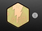 PCB coaster featuring three friendly LEDs next to a US quarter.