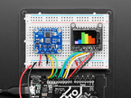 Sensor wired to Arduino and TFT, with color spectrogram displayed.