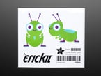 Animated green and purple Cricket sticker displaying the front profile and the side profile of the Cricket.