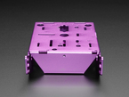 Front of purple aluminum metal robot chassis with many holes and mounting tabs.