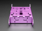 Back of purple aluminum metal robot chassis with many holes and mounting tabs.