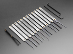 Array of many lock picks with silver handles, plus wrenches