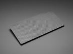 Angled shot of unpowered flexible 64x32 RGB LED matrix.