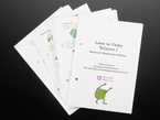 """Top view shot of loose booklet pages """"Love To Code: Volume 1 Add-on Booklet Kit - Microsoft MakeCode Edition"""""""