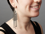 Earring shown being worn from the side profile