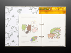 Open kids' technical book with friendly woodland creatures teaching about coding.