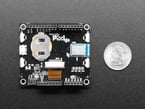 Bottom component shot with Arduino headers, BLE module, coin cell holder.