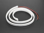 Coil of neon-looking silicone tube