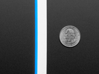 Close up of unlit neon-like silicone LED strip next to quarter