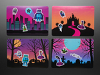 Top view of four postcards with different Halloween-inspired backgrounds. The cards have Circuit Playground character stickers.
