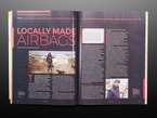 Open magazine spread to feature on locally made airbags.