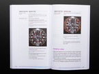 Open book spread featuring example code for Circuit Playground Express.