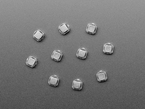 Topdown shot of ten 6mm black mini soft touch pushbutton switches.