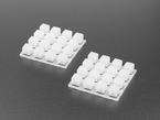 Angled shot of two white 4x4 silicone elastomer button keypads.