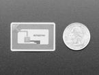 Sticker next to quarter