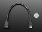 Snap-In Panel Mount HDMI Cable next to quarter for size comparison