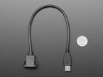 Snap-In Panel Mount Cable - USB A Extension Cable next to quarter for size reference