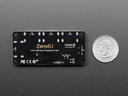 Under shot of the USB board showing the 'Zero4U' logo. Next to quarter for size reference