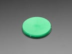 round green disc of fluorescent paint out of packaging.