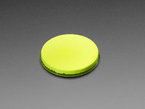 round yellow disc of fluorescent paint without lid.