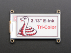 "Front of E-Ink display with Tri-color graphic and ""2.13 inch E-Ink Tricolor"" text"