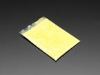 Angled shot of clear baggy containing yellow thermochromic pigment powder.
