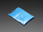 Angled shot of clear baggy containing blue thermochromic pigment powder.