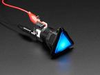 Angled shot of a red triangle illuminated LED pushbutton.