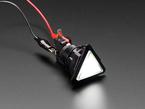 Angled shot of a white triangle illuminated LED pushbutton.