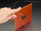 Hand holding acrylic piece with installed USB Micro B Jack to USB A Jack Round Panel Mount Adapter