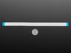 Long flexible flat cable next to quarter