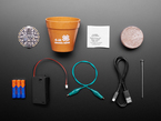Kit contents with Circuit Playground, cables, batteries, and sprouting kit