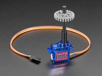Plastic Micro Servo Adapter for LEGO Cross attached to servo