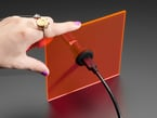 Hand holding acrylic piece with installed USB C Jack to USB A Jack Round Panel Mount Adapter