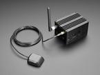 Angled shot of assembled black aluminum Pilot Gateway Pro LoRa Enclosure Kit for Raspberry Pi 3.