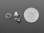 Profile of jack and mounting nut, next to quarter