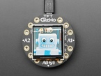 Round TFT bolted to Circuit Playground, showing colorful image of friendly robot
