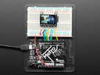 TFT breakout wired up on breadboard to Arduino, showing colorful image of friendly owl