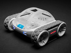 Angled shot of four-wheeled robot rover with LED eyes.