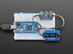 Adafruit LPS33HW Water Resistant Pressure Sensor wired to a Feather and OLED via QT cables