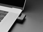 Shot of adapter plugged into laptop with the adapter in an upper position