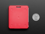 Back of a red case next to US quarter.