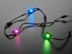 Three Ultra Bright 3 Watt Chainable NeoPixel LEDs glowing rainbow