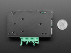 Back side of mounting plate, next to quarter